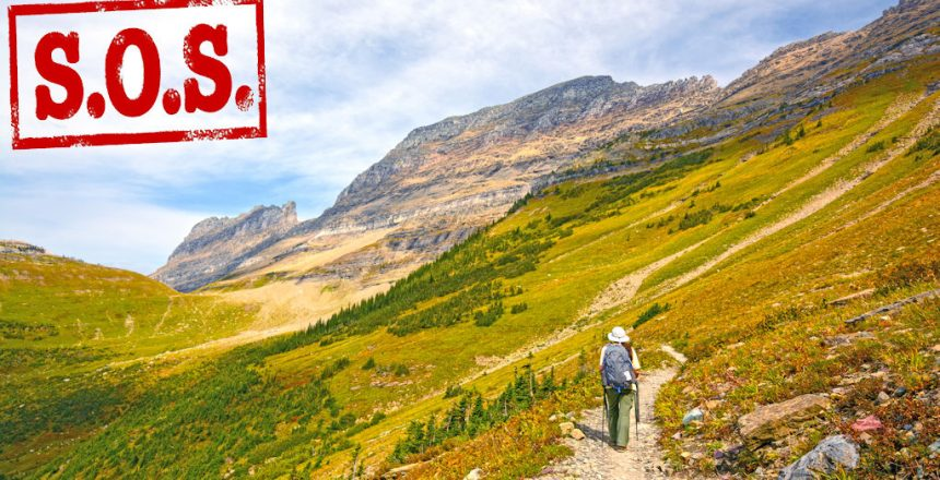 Hiker Trekking on the Highline Trail in Glacier National Park in Montana in the Fall